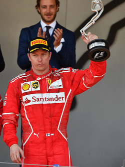 Kimi Raikkonen, Ferrari on the podium with the trophy