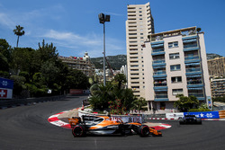 Jenson Button, McLaren MCL32, chases Pascal Wehrlein, Sauber C36-Ferrari, on the opening lap