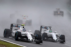 Valtteri Bottas, Williams FW38 and team mate Felipe Massa, Williams FW38 battle for position