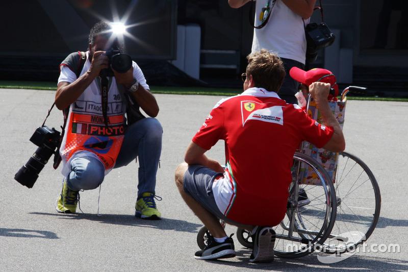 Sebastian Vettel, Ferrari with a young fan