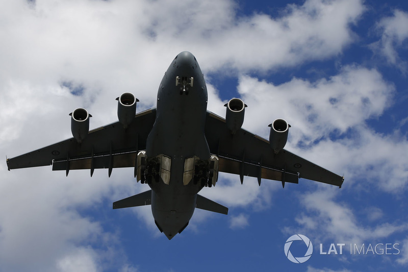 A Royal Australian Air Force Boeing C-17A Globemaster III performs a dirty pass over the grid prior
