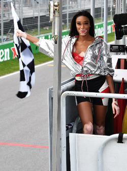 Winnie Harlow, waves the chequered flag
