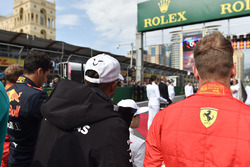 Lewis Hamilton, Mercedes-AMG F1 and Sebastian Vettel, Ferrari on the grid