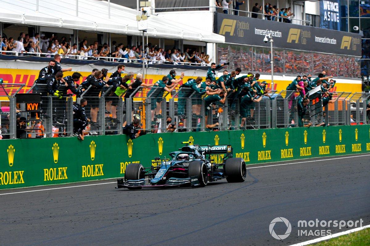 Sebastian Vettel, Aston Martin AMR21, 2nd position, is cheered over the line