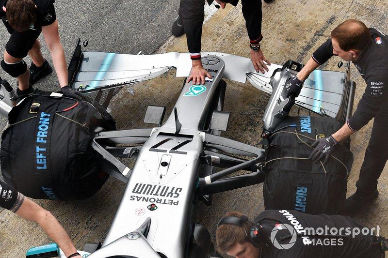 Team members push the car of Valtteri Bottas, Mercedes AMG F1 W10, into the garage