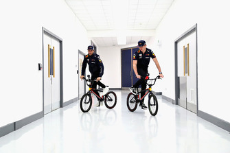 Max Verstappen, Red Bull Racing and Daniel Ricciardo, Red Bull Racing ride bikes in the factory