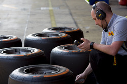 A pirelli engineer checking tyre temperatures