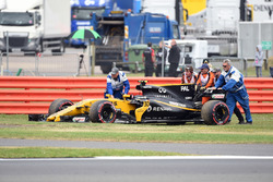 Marshals push the car of race retiree Jolyon Palmer, Renault Sport F1 Team RS17 after stopping on track on the parade lap