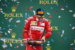 Kimi Raikkonen, Ferrari celebrates on the podium, the champagne