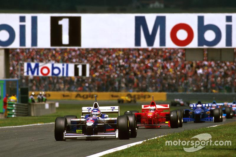 Jacques Villeneuve, Williams FW19 Renault leads Michael Schumacher, Ferrari F310B and Olivier Panis, Prost JS45 Mugen Honda