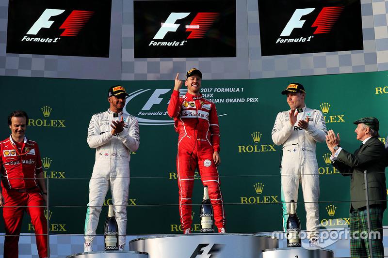 Podium: ganador, Sebastian Vettel, Ferrari, segundo, Lewis Hamilton, Mercedes AMG F1, tercero, Valtt