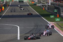 Romain Grosjean, Haas F1 Team VF-18 Ferrari,leads Esteban Ocon, Force India VJM11 Mercedes, and Sergio Perez, Force India VJM11 Mercedes