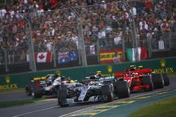 Lewis Hamilton, Mercedes AMG F1 W09, leads Kimi Raikkonen, Ferrari SF71H, Sebastian Vettel, Ferrari SF71H, Kevin Magnussen, Haas F1 Team VF-18 Ferrari, Max Verstappen, Red Bull Racing RB14 Tag Heuer, and Romain Grosjean, Haas F1 Team VF-18 Ferrari, at the start