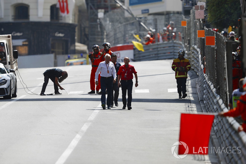 Charlie Whiting, Race Director, FIA, conducts a circuit inspection during a red flag
