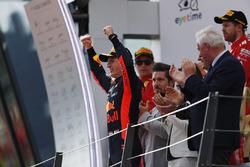 Max Verstappen, Red Bull Racing, celebrates on the podium, along with second place Kimi Raikkonen, Ferrari, and third place Sebastian Vettel, Ferrari