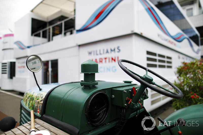 A tractor next to the Williams hospitality unit