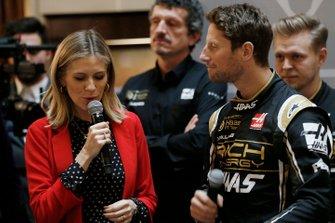 Presenter Nicki Shields and Romain Grosjean, Haas F1 Team