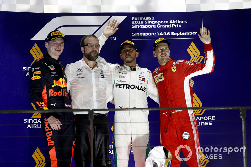 Max Verstappen, Red Bull Racing, 2nd position, the Mercedes Constructors Trophy delegate, Lewis Hamilton, Mercedes AMG F1, 1st position, and Sebastian Vettel, Ferrari, 3rd position, on the podium