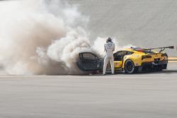 Marcel Fässler with a fire extinguisher at the #4 Corvette Racing Chevrolet Corvette C7.R on fire