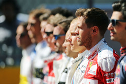 Sebastian Vettel, Ferrari as the grid observes the national anthem