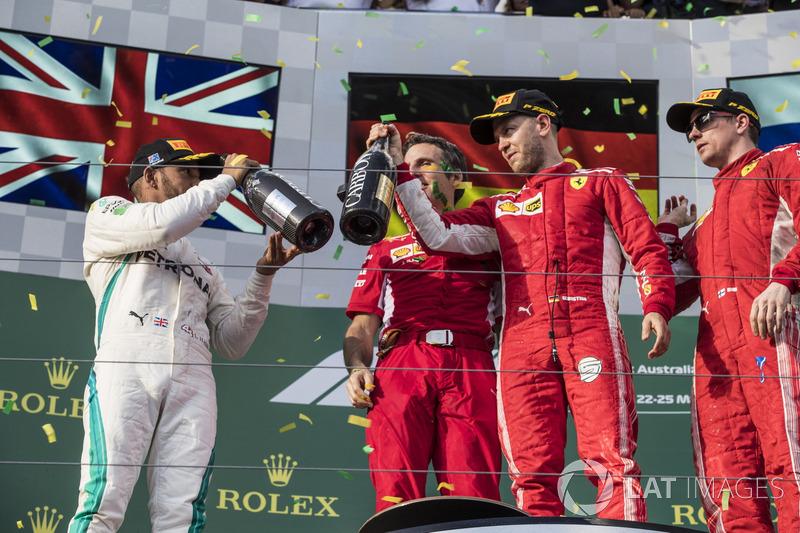 Lewis Hamilton, Mercedes-AMG F1, Inaki Rueda, Ferrari Race Strategist, Sebastian Vettel, Ferrari and Kimi Raikkonen, Ferrari celebrate on the podium with the champagne