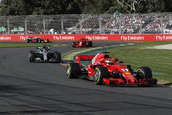 Sebastian Vettel, Ferrari SF71H leads Lewis Hamilton, Mercedes-AMG F1 W09