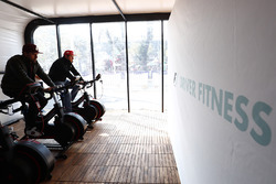 Fans get involved on exercise bikes with an F1 driver fitness display