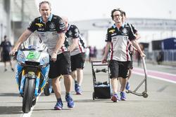 Pushing Franco Morbidelli's Marc VDS Honda to scrutineering