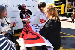 Charles Leclerc, Alfa Romeo Sauber F1 Team signs a flag for fans