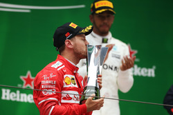 Sebastian Vettel, Ferrari kisses his trophy on the podium