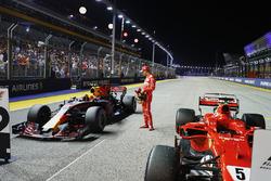 Pole sitter Sebastian Vettel, Ferrari, inspects the Redbull
