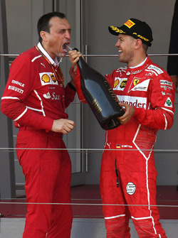 Race winner Sebastian Vettel, Ferrari with Riccardo Adami, Ferrari Race Engineer and the champagne