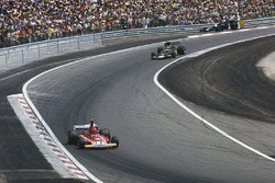 Niki Lauda, Ferrari 312B3, leads Ronnie Peterson, Lotus 72E Ford