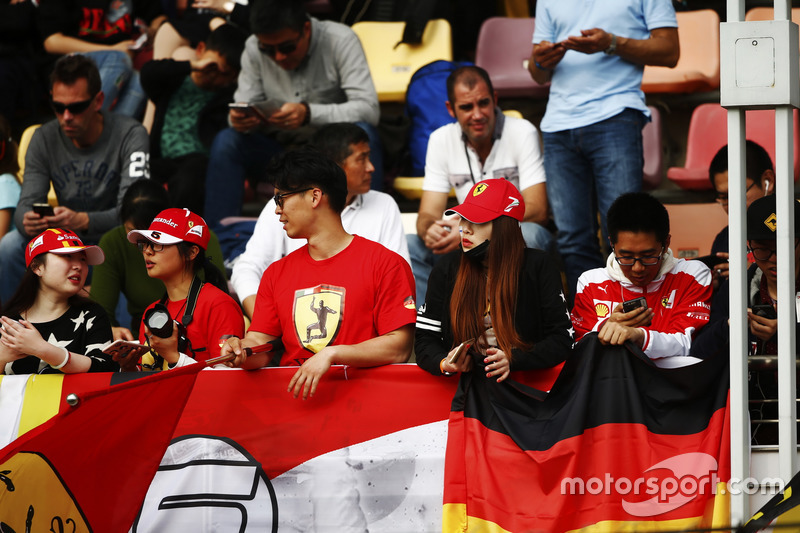 Chinese Ferrari fans display their support in a grandstand
