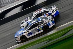 Clint Bowyer, Stewart-Haas Racing Ford, races Dale Earnhardt Jr., Hendrick Motorsports Chevrolet
