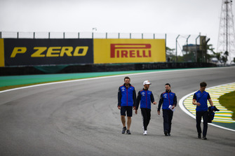 Pierre Gasly, Toro Rosso, walks the circuit with colleagues
