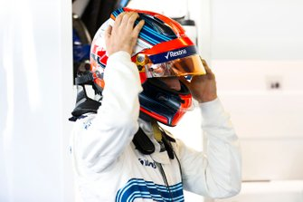 Robert Kubica, Williams Martini Racing, adjusts his crash helmet