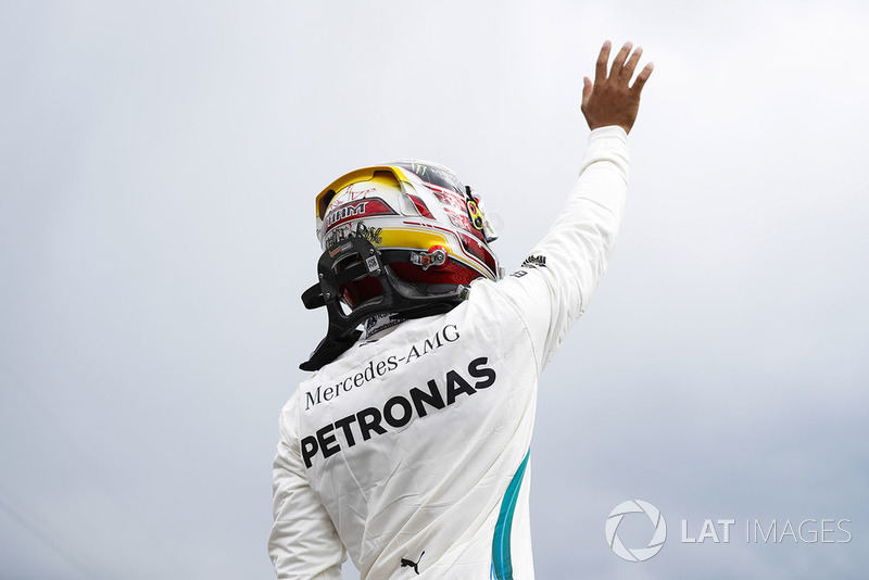 Lewis Hamilton, Mercedes AMG F1, waves after setting pole position