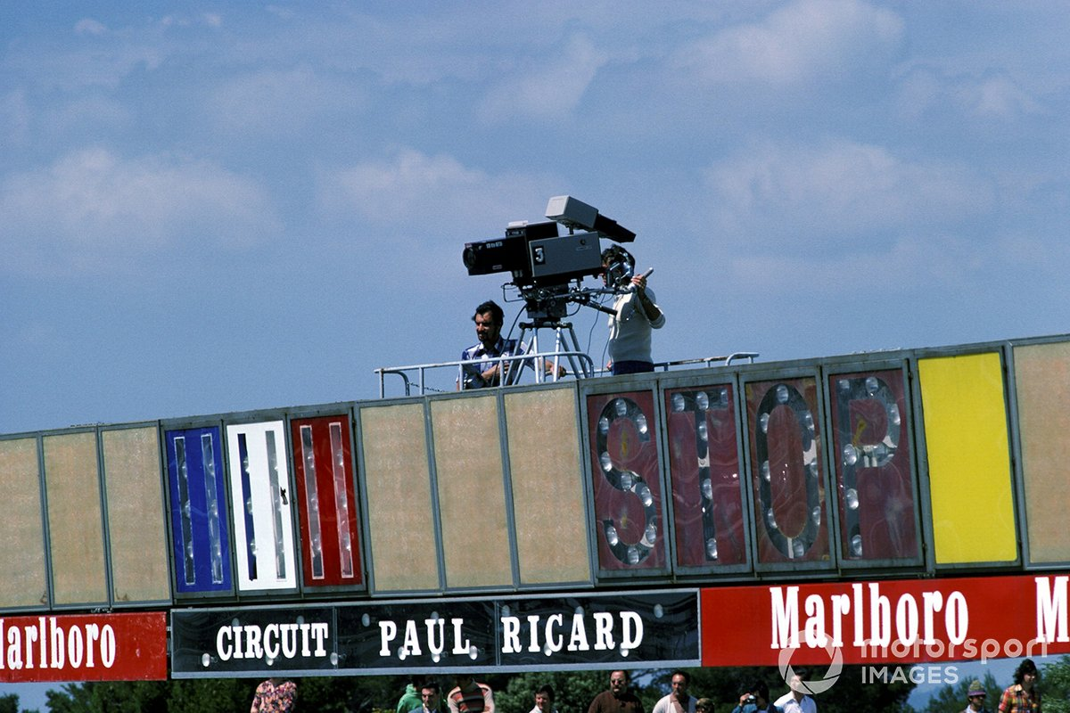 A television cameraman prepares to film the race from the gantry above the start/finish line