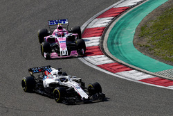 Lance Stroll, Williams FW41 and Esteban Ocon, Force India VJM11