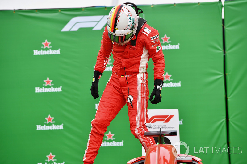 Race winner Sebastian Vettel, Ferrari celebrates in parc ferme