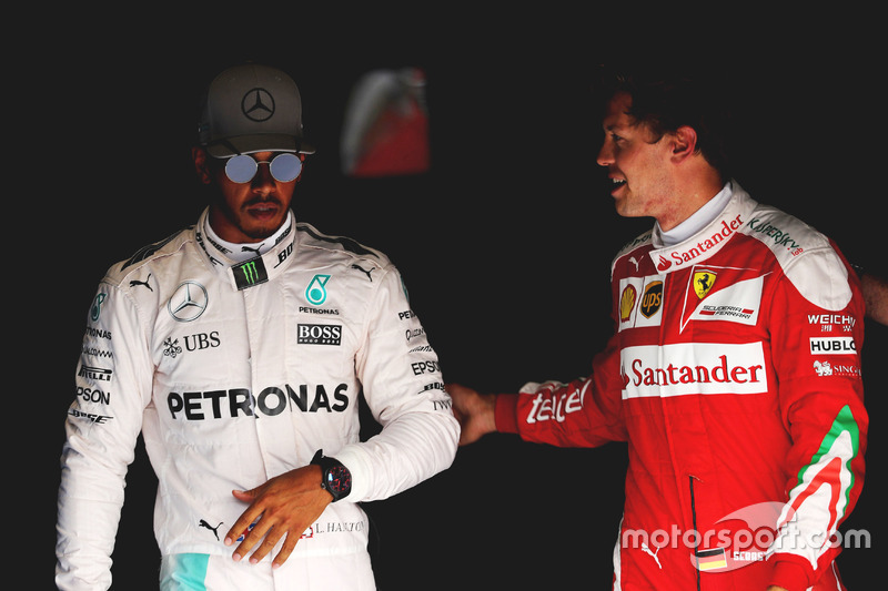 (L to R): Pole sitter Lewis Hamilton, Mercedes AMG F1 with third placed Sebastian Vettel, Ferrari in