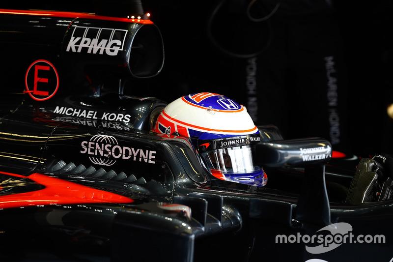 Jenson Button, McLaren waits in his cockpit in the garage