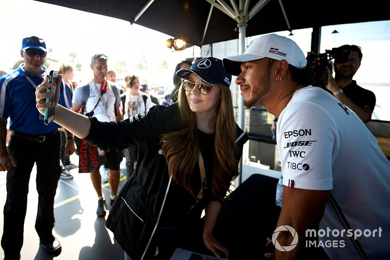 Lewis Hamilton, Mercedes AMG F1, takes as selfie with a fan