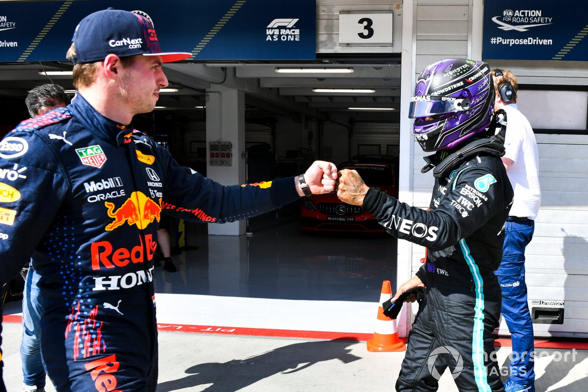 Pole man Lewis Hamilton, Mercedes, fist bumbs Max Verstappen, Red Bull Racing, in Parc Ferme after Qualifying