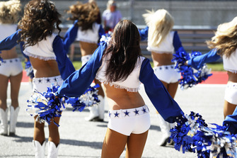 The Dallas Cowboys Cheerleaders join the pre race grid celebrations