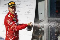 Sebastian Vettel, Ferrari, 1st Position, celebrates victory on the podium