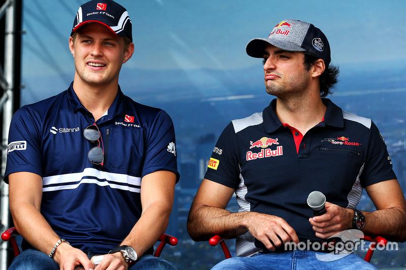 Marcus Ericsson, Sauber; Carlos Sainz Jr., Scuderia Toro Rosso