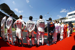 The drivers stand to attention for the national anthem. L-R: paul di Resta, Lance Stroll, Williams, Kevin Magnussen, Haas F1 Team, Sergio Perez, Force India, Esteban Ocon, Force India, Carlos Sainz Jr., Scuderia Toro Rosso, Fernando Alonso, McLaren, Daniil