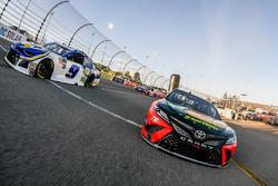 Martin Truex Jr., Furniture Row Racing, Toyota Camry Bass Pro Shops/5-hour ENERGY and Chase Elliott, Hendrick Motorsports, Chevrolet Camaro NAPA Auto Parts lead the field to the green